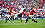 Dele Alli of Tottenham Hotspur scores the opening goal of the game as he's  challenged by Luis Antonio Valencia of Manchester United during the FA cup semi-final match at Wembley Stadium, London. Picture date 21st April, 2018. Picture credit should read: Robin Parker/Sportimage