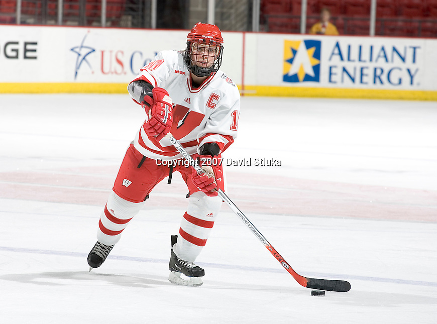 MADISON, WI - FEBRUARY 16: Bobbi-Jo Slusar #10 of the Wisconsin Badgers women's hockey team handles the puck against the Bemidji State Beavers at the Kohl Center on February 16, 2007 in Madison, Wisconsin. The Badgers beat the Beavers 2-0. (Photo by David Stluka)