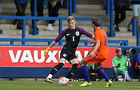 Goalkeeper Will Mannion (Hull City) of England U19  takes the ball around Odysseus Valanas of Holland during the International match between England U19 and Netherlands U19 at New Bucks Head, Telford, England on 1 September 2016. Photo by Andy Rowland.