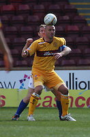 Michael Higdon shields the ball from Frazer Wright in the Motherwell v St Johnstone Clydesdale Bank Scottish Premier League match played at Fir Park, Motherwell on 28.4.12.