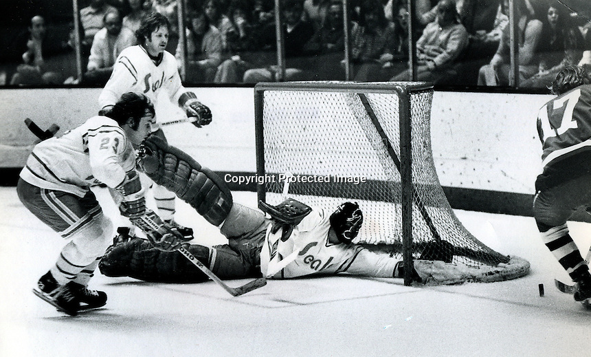 Seals #23 Tim Jacobs, Len Frig and goalie Gary Simmons. (1976 photo by Ron Riesterer)