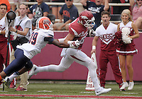 NWA Democrat-Gazette/BEN GOFF @NWABENGOFF<br /> Drew Morton, Arkansas wide receiver, breaks the tackle of UTEP defender Michael Lewis on his way to a touchdown on Saturday Sept. 5, 2015 during the first quarter of the Arkansas vs UTEP game at Razorback Stadium in Fayetteville.