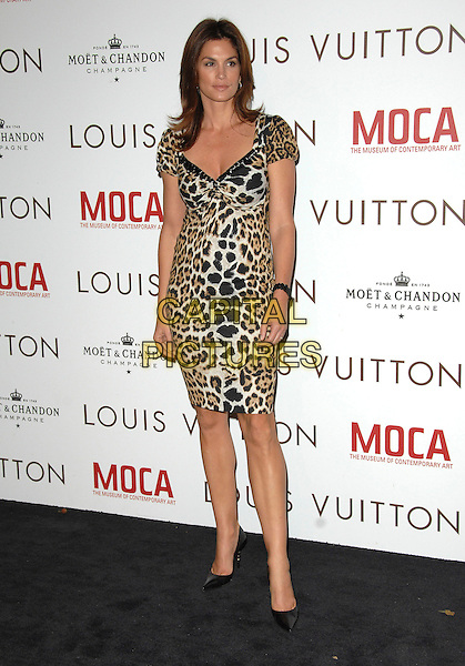 CINDY CRAWFORD.at The Louis Vuitton Gala Celebrating Murakami Exhibition held at  The Geffen Contemporary at MOCA in Los Angeles, California, USA, October 28 2007.                                           full length leopard print dress black shoes.CAP/DVS.©Debbie VanStory/Capital Pictures