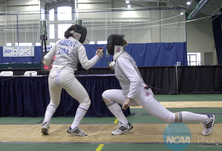 22 MAR 2002:  Andrea Ament, of Notre Dame, (L), and Alicja Kryczalo, also of Notre Dame, (R) battle during the women's foil finals of the NCAA Fencing Championship held in the William E. and Carol G. Simon Forum at Drew University in Madison, NJ. Alicja Kryczalo, of Notre Dame, defeated Andrea Ament, also of Notre Dame, 15-6. John Munson/NCAA Photos