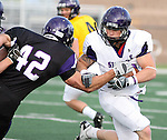 SIOUX FALLS, SD - APRIL 28: Dakota Fiene #30 of the University of Sioux Falls tries to elude defender Jonathan Talbot #42 during the Cougars spring scrimmage Saturday evening at Bob Young Field. (Photo by Dave Eggen/Inertia)