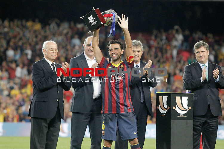 FC Barcelona's Xavi Hernandez with the winner trophy of the  Supercup of Spain.August 28,2013. Foto © nph / Acero)