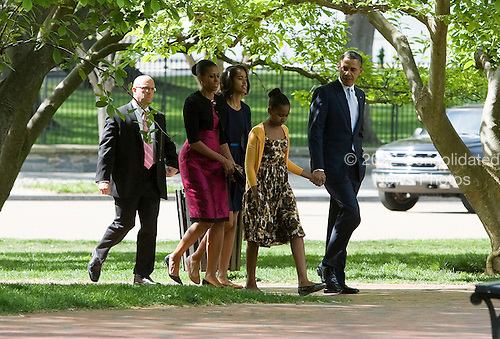 United States President Barack Obama, First Lady Michelle Obama and daughters Sasha and Malia Obama walk across Lafayette Park to attend easter services at St. John's Episcopal Church in Washington, D.C. on Sunday, April 8, 2012. .Credit: Kristoffer Tripplaar  / Pool via CNP