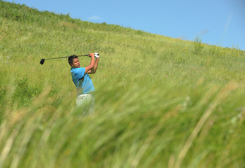 Dillon Worm-Poorman, an Aboriginal golfer from Saskatoon, Sask., crushes a drive on the par five 17th hole at the Deer Valley Golf Club in Lumsden, Sask. MARK TAYLOR GALLERY.
