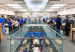 People at multi-storey Apple store trying new devices. Ginza, Tokyo, Japan 2014