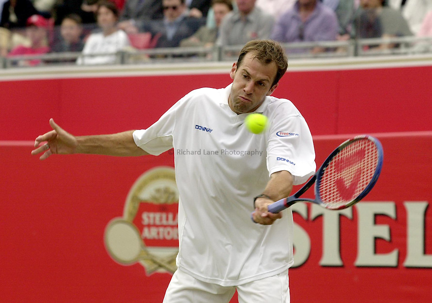Photo:Ken Brown .11/06/2001. .Stella Artois Championship 2001 .Greg Rusedski plays a fore hand in his match against Vladimir Voltchkov