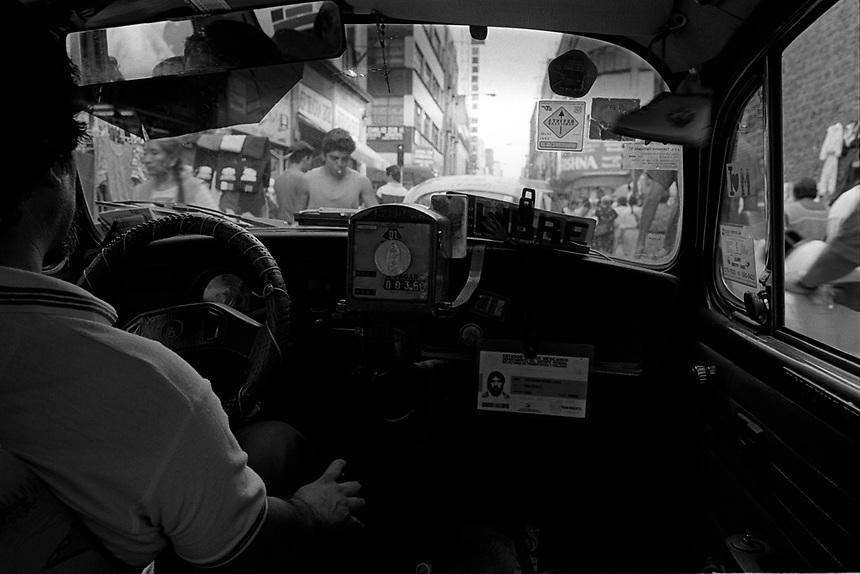 The interior of a VW bug taxi in Mexico City's historical center.  Mexico, 1995