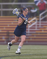 University of New Hampshire midfielder Kate Keagins (6) brings the ball forward. Boston College defeated University of New Hampshire, 11-6, at Newton Campus Field, May 1, 2012.z