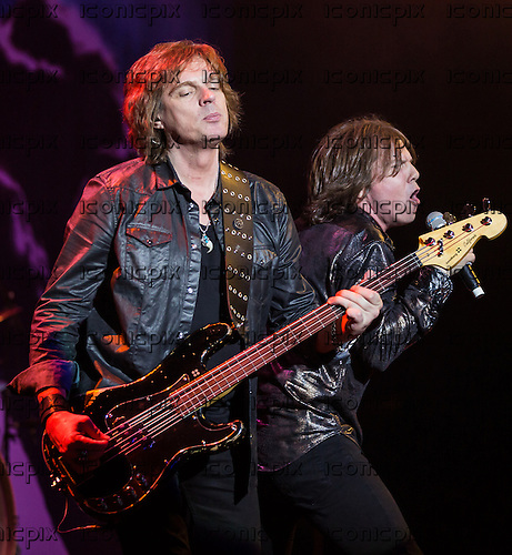 Europe Basist John Levèn (L) and Vocalist Joey Tempest (R) performing live at Hammersmith Apollo London UK - 13 April 2014.  Photo credit: Iain Reid/IconicPix