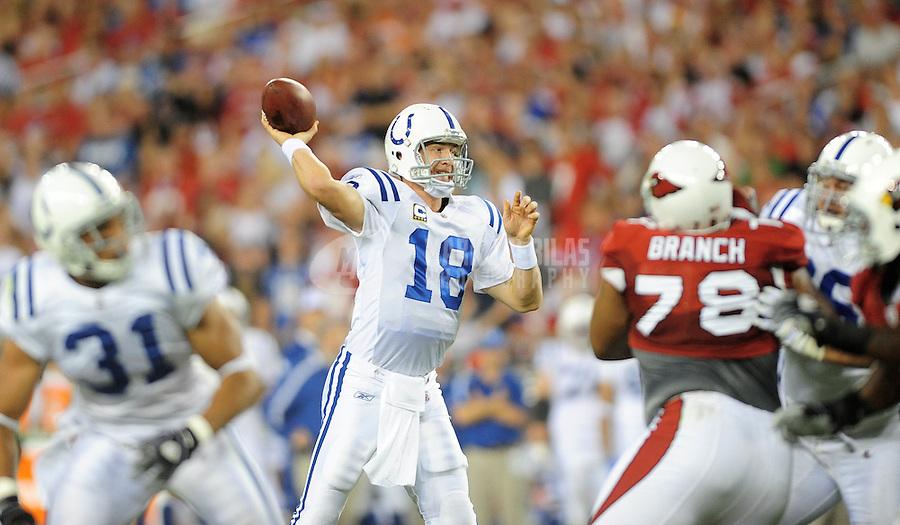 Sept. 27, 2009; Glendale, AZ, USA; Indianapolis Colts quarterback (18) Peyton Manning throws a pass in the second quarter against the Arizona Cardinals at University of Phoenix Stadium. Mandatory Credit: Mark J. Rebilas-