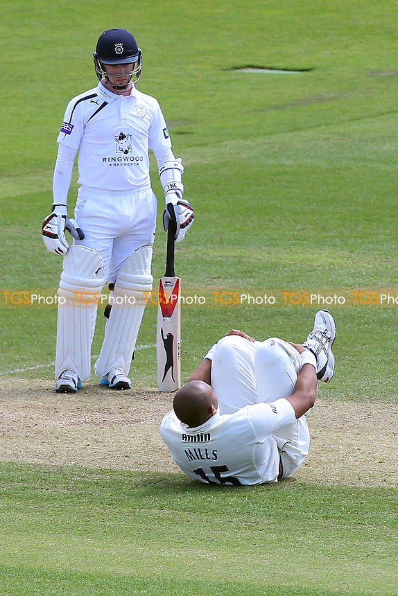 Adam Wheater of Hampshire looks on as Tymal Mills of Essex goes down with an injury whilst bowling - Hampshire CCC vs Essex CCC - LV County Championship Division Two Cricket at the Ageas Bowl, West End, Southampton - 17/06/14 - MANDATORY CREDIT: Gavin Ellis/TGSPHOTO - Self billing applies where appropriate - 0845 094 6026 - contact@tgsphoto.co.uk - NO UNPAID USE