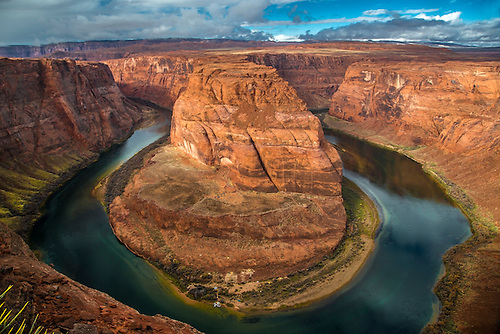 The Colorado River winds its way through the Northern Arizona landscape at Horseshoe Bend near Page, Arizona