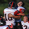 Joe Parlato #44, right, and Brian Bornkamp #18 of Plainedge celebrate with their teammates after a thrilling 38-34 win over host Lawrence High School in Nassau County Conference III varsity football game on Saturday, Sept. 23, 2017. Bornkamp caught four passes for touchdowns, including the game-winner with 23.3 seconds remaining in the fourth quarter.