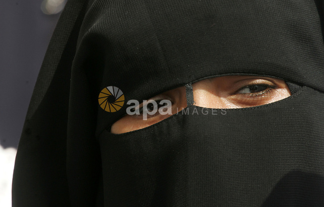A veiled Palestinian schoolgirl looks on during an anti-Israel protest in the southern Gaza Strip town of Rafah on October 14, 2015. Amid violent protests and a wave of stabbings spreading fear in Israel and warnings that a full-scale uprising could erupt, a new generation of Palestinians has been leading the unrest. Photo by Abed Rahim Khatib