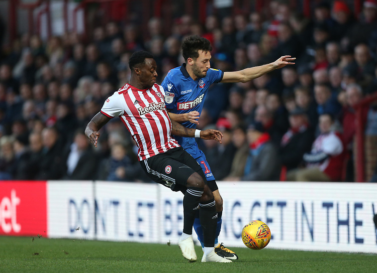 Bolton Wanderers' Will Buckley and Brentford's Moses Odubajo<br /> <br /> Photographer Rob Newell/CameraSport<br /> <br /> The EFL Sky Bet Championship - Brentford v Bolton Wanderers - Saturday 22nd December 2018 - Griffin Park - Brentford<br /> <br /> World Copyright © 2018 CameraSport. All rights reserved. 43 Linden Ave. Countesthorpe. Leicester. England. LE8 5PG - Tel: +44 (0) 116 277 4147 - admin@camerasport.com - www.camerasport.com
