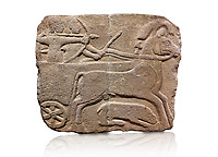 Hittite monumental relief sculpted orthostat stone panel. Limestone, Karkamıs, (Kargamıs), Carchemish (Karkemish), 900-700 B.C. Hunting carriage.  Anatolian Civilisations Museum, Ankara, Turkey.<br /> <br /> Two human figures; one handling the carriage, the other throwing arrows. Both figures are wearing a headdress shaped like a skullcap. The dagger at the waist of the figure throwing arrow draws attention. There is an animal between the legs of the horse having an aigrette over its head. <br /> <br /> Against a white background.