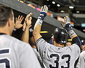 Baltimore, MD - September 2, 2009 -- New York Yankees first baseman Nick Swisher (33) celebrates with his teammates in the dug-out after scoring in the ninth inning against the Baltimore Orioles at Oriole Park at Camden Yards in Baltimore, MD on Wednesday, September 2, 2009.  The Yankees won the game 10 - 2..Credit: Ron Sachs / CNP.(RESTRICTION: NO New York or New Jersey Newspapers or newspapers within a 75 mile radius of New York City)