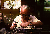 Egypt. Cairo. Engraver working on silver in the souk.