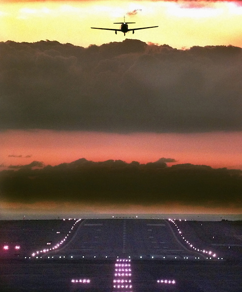 C.sbsky.0120.jl.photo lytle.An airplane flies in for a landing at Palomar Airport, Tuesday evening.