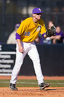 First baseman John Wooten #16 of the East Carolina Pirates on defense versus the Virginia Cavaliers at Clark-LeClair Stadium on February 20, 2010 in Greenville, North Carolina.   Photo by Brian Westerholt / Four Seam Images