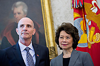 United States Secretary of Transportation Elaine Chao, right, listens as US President Donald Trump, not pictured, speaks while meeting with the crew and passengers of Southwest Airlines Co. flight 1380 in the Oval Office of the White House in Washington, D.C., U.S., on Tuesday, May 1, 2018. An engine on Southwest's flight 1380, a Boeing Co. 737-700 bound for Dallas from New York's LaGuardia airport, exploded and made an emergency landing on April 17 sending shrapnel into the plane and killing a passenger seated near a window. <br /> Credit: Andrew Harrer / Pool via CNP /MediaPunch