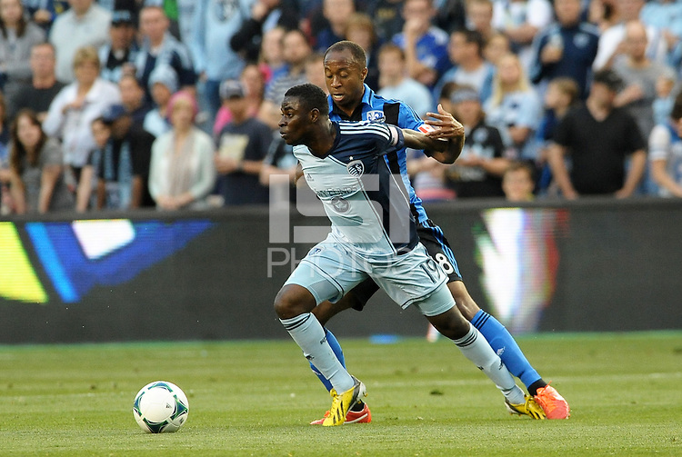 Peterson Joseph (19) midfield Sporting KC marked by Patrice Bernier (8) midfield Montreal Impact .<br />