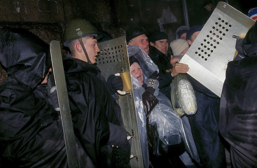 Moscow, Russia, 02/10/1993..Riot police break up a group of opposition demonstrators near the Russian Parliament. When President Boris Yeltsin dissolved the opposition-dominated Russian Parliament,  deputies and supporters, led by Vice President Alexander Rutskoi, barricaded themselves inside the White House. After a 10 day stand-off the situation exploded into violence between pro and anti Yeltsin forces.
