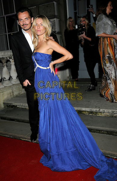 MATTHEW WILLIAMSON & SIENNA MILLER .Attending the Colin MacDowell book launch party, Somerset House, London, England, UK, October 13th 2010..full length designer muse blue cobalt long maxi dress gown suit black white shirt silver one strap shoulder hand on hip .CAP/CAN.©Can Nguyen/Capital Pictures.