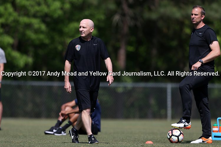 CARY, NC - APRIL 20: Head coach Paul Riley (ENG) (center) with assistant coach Scott Vallow (right). The North Carolina Courage held a training session on April 20, 2017, at WakeMed Soccer Park Field 7 in Cary, NC.