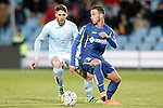 Getafe's Alvaro Vazquez (r) and Celta de Vigo's Sergi Gomez during La Liga match. February 27,2016. (ALTERPHOTOS/Acero)