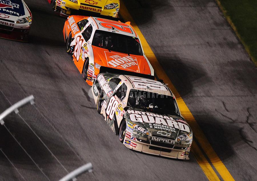 Jul. 3, 2010; Daytona Beach, FL, USA; NASCAR Sprint Cup Series driver Dale Earnhardt Jr. (88) leads Joey Logano (20) during the Coke Zero 400 at Daytona International Speedway. Mandatory Credit: Mark J. Rebilas-