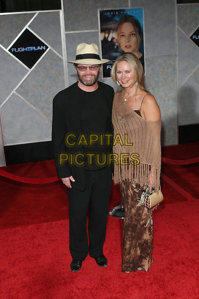 "MICKY DOLENZ & WIFE.Arrivals for the premiere of ""Flight Plan"" at El Capitan Theatre, Hollywood,.Los Angeles, 20th September 2005.full length black suit cream hat brown shawl poncho.Ref: ADM/ZL.www.capitalpictures.com.sales@capitalpictures.com.© Capital Pictures."