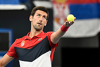 11th January 2020; Sydney Olympic Park Tennis Centre, Sydney, New South Wales, Australia; ATP Cup Australia, Sydney, Day 9; Serbia versus Russia;  Novak Djokovic versus Daniil Medvedev; Novak Djokovic of Serbia tosses the ball before serving to Daniil Medvedev of Russia - Editorial Use