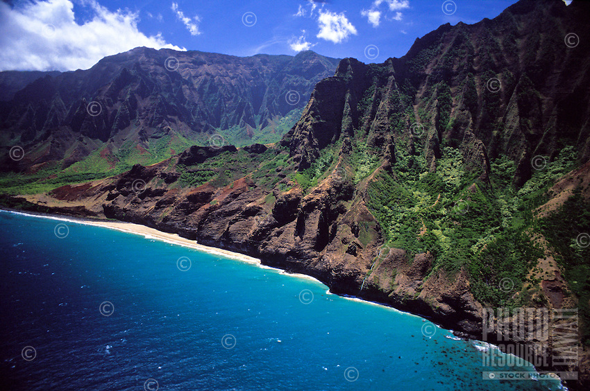 Aerial of the Na Pali coastline, Kauai northern pristine mountains