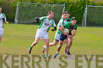 Churchill's Benny Dillon and Na Gaeil's Owen Doody in action in the Junior Club Football Championship at The Spa on Sunday.