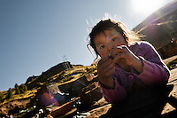 A Peruvian girl takes a rest while working with her parents at a brick factory in the outskirts of Puno, Peru, 6 August 2012. Child labour is a common practice at the artisanal brick factories, found predominantly in socially deprived areas of the urban zones. Poverty and lack of employment force parents, mainly season workers coming from rural areas of the country, to employ their own children, in an effort to ensure the livelihood for the whole family. Children aged 4-7 take part in simple jobs while children aged 8 and up tend to work regularly, same as adults. A family group, consisting of 2 adults and 2-3 children, may earn 20-25 USD per day, working almost the whole day, often in harsh climatic conditions.