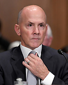"""Richard F. Smith, former Chairman and Chief Executive Officer, Equifax, Inc. adjusts his tie prior to giving testimony before the United States Senate Committee on Banking, Housing, and Urban Affairs as they conduct a hearing entitled, """"An Examination of the Equifax Cybersecurity Breach"""" on Capitol Hill in Washington, DC on Tuesday, October 3, 2017. <br /> Credit: Ron Sachs / CNP"""