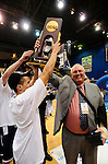 19 MAR 2011: Tournament MVP Tyler Nicolai (4) of St. Thomas presents the championship trophy to head coach Steve Fritz after their win at the Division III Men's Basketball Championship held at the Salem Civic Center in Salem, VA.  The University of St. Thomas (Minnesota) defeated College of Wooster 78-54 to win the national title.  Andres Alonso/NCAA Photos
