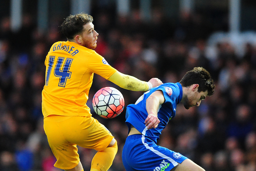 Preston North End's Joe Garner vies for possession with Peterborough United's Jack Baldwin<br /> <br /> Photographer Chris Vaughan/CameraSport<br /> <br /> Football - The FA Cup Third Round - Peterborough United v Preston North End - Saturday 9th January 2016 - ABAX Stadium - Peterborough <br /> <br /> &copy; CameraSport - 43 Linden Ave. Countesthorpe. Leicester. England. LE8 5PG - Tel: +44 (0) 116 277 4147 - admin@camerasport.com - www.camerasport.com