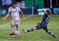 17th July 2020, Orlando, Florida, USA;  Minnesota United midfielder Thomas Chacon (11) stretches to block the pass of Real Salt Lake defender Aaron Herrera (22) during the MLS Is Back Tournament between the Real Salt Lake versus Minnesota United FC on July 17, 2020 at the ESPN Wide World of Sports, Orlando FL.