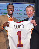 Washington Redskins head coach Joe Gibbs, right, and wide receiver Brandon Lloyd (1), left, who they acquired from the San Francisco 49ers in a trade for two draft choices, hold up the player's new jersey at a press conference at Redskins Park in Ashburn, Virginia on March 13, 2006.<br /> Credit: Arnie Sachs / CNP