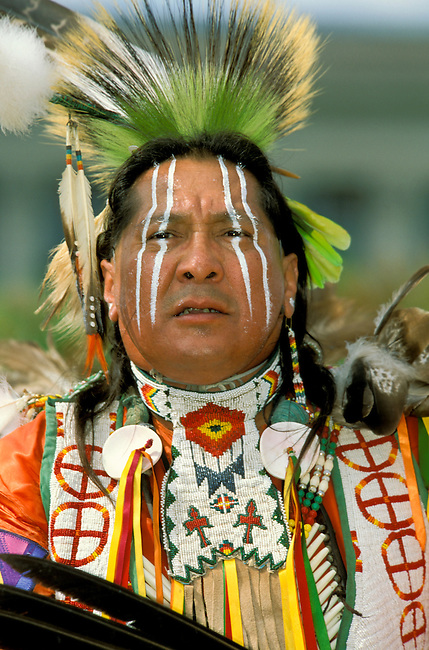 Kiowa man dressed in traditional beaded regalia and painted face during a celebration at the Oklahoma State Capital building.