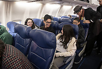 Seated, from left, Bia Pinho '23, Joaquin Madrid Larranaga '23 and Madeline Martell '21 in their seats on the Southwest Airlines airplane at Burbank Airport.<br /> Eleven Occidental College first-years and sophomores traveled with Career Services staff and Senior Associate Dean of Students Erica O'Neal Howard to San Francisco for a day to visit Cambridge Associates, managers of Oxy's endowment, as part of their workforce diversity initiative. They were invited to meet with employees (including two alums), tour the office, and learn about careers in investment management. Students were able to see how their quantitative courses could be applied to future career opportunities.<br /> January 17, 2020.<br /> (Photo by Marc Campos, Occidental College Photographer)