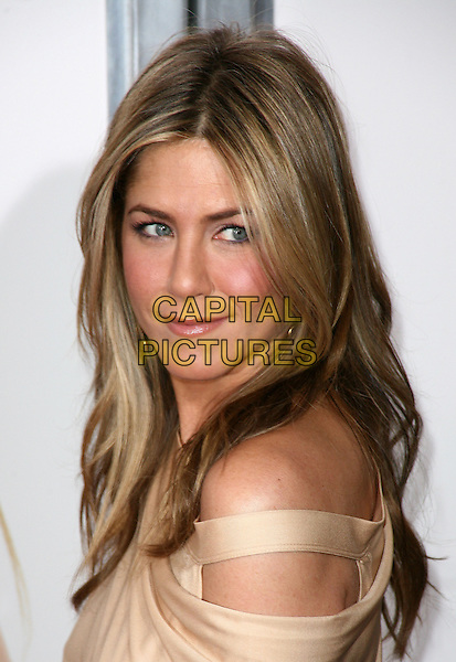 JENNIFER ANISTON.At the New York City film premiere of 'The Bounty Hunter' at Ziegfeld Theatre in New York City, NY, USA, .March 16, 2010 .arrivals portrait headshot  make-up beige gold cut out off the shoulder nude side looking over shoulder .CAP/ADM/PZ.©Paul Zimmerman/Admedia/Capital Pictures