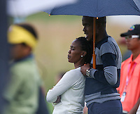 Spectators huddle under umbrellas as the weather closes in during Round Three of The Tshwane Open 2014 at the Els (Copperleaf) Golf Club, City of Tshwane, Pretoria, South Africa. Picture:  David Lloyd / www.golffile.ie