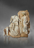 Roman Sebasteion relief  sculpture of Apollo and a Muse Aphrodisias Museum, Aphrodisias, Turkey.  Against a grey background.<br /> <br /> On the left stood Apollo, one foot raised on a rock, playing his lyre which rests on top of the omphalos (the earth&rsquo;s navel stone, tied down at Delphi(. On the right stands a muse holding one arm of Apollos lyre.